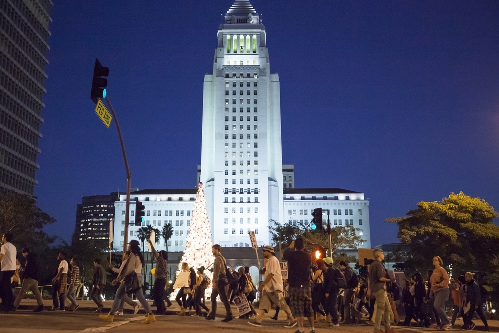 Protesters march in front of City Hall during a rally in support for Mike Brown on Wednesday Nov. 26, 2014. Mike Brown was shot in Ferguson, Miss. by officer Darren Wilson after a confrontation between the two. Brown's death and officer Wilson's non-indictment sparked a national debate and outrage over the use of deadly force by police. Los Angeles, Calif.