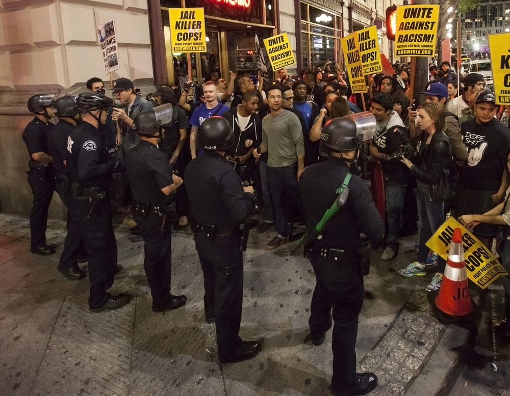 Protesters during a rally in support of Mike Brown are blocked by LAPD officers creating a bottleneck with nowhere to exit. Soon after being blocked, the LAPD gave the protesters a four minute warning to disperse or risk being arrested for unlawful assembly. Wednesday Nov. 26, 2014. Los Angeles, Calif.