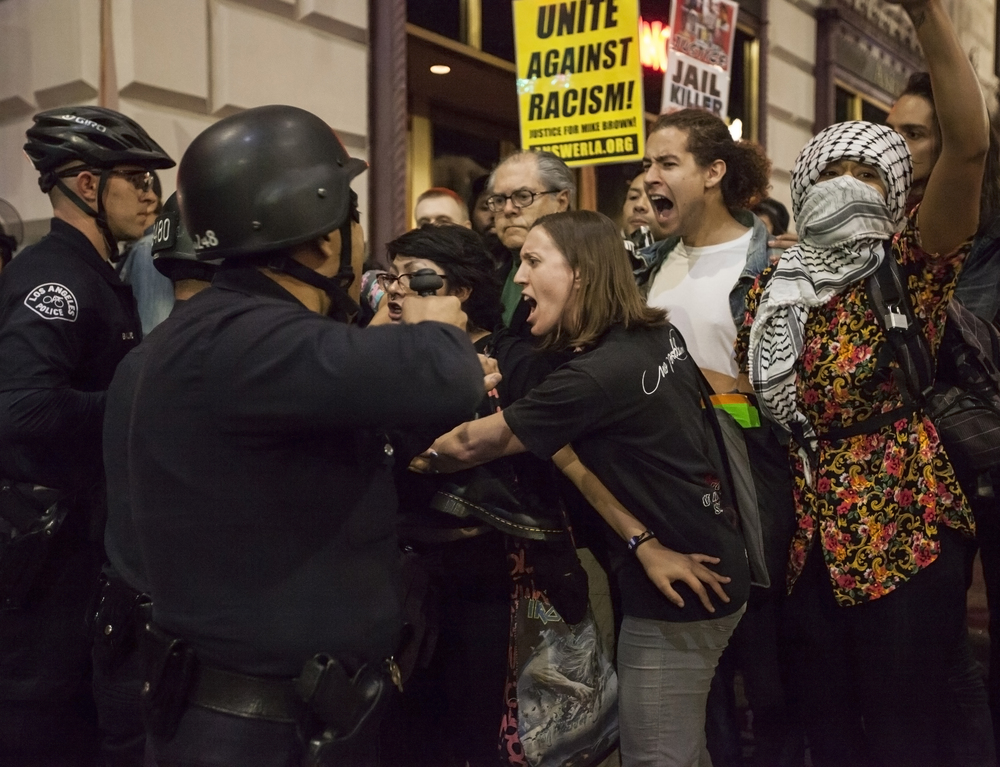 Emotions ran high between police and protesters during a rally in support of Mike Brown. LAPD officers created a bottleneck by blocking protesters with nowhere to exit. Soon after being blocked, the LAPD gave the protesters a four minute warning to disperse or risk being arrested for unlawful assembly. Wednesday Nov. 26, 2014. Los Angeles, Calif.