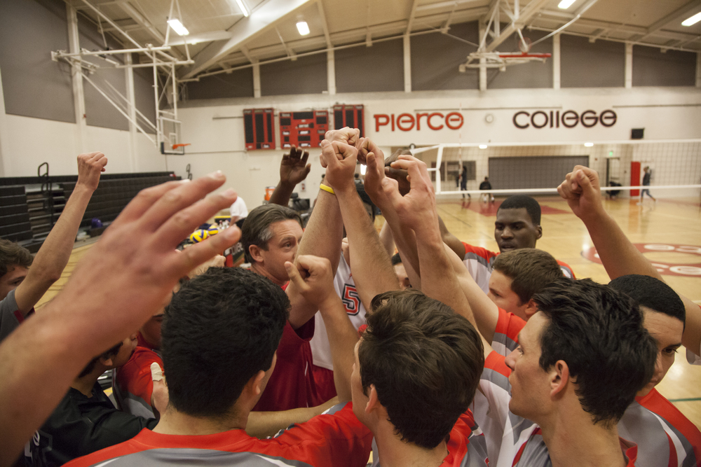 The mens volleyball team raise their hands after a timeout during a match against Golden West College on Wednesday Feb. 18. Pierce would win the match in straight sets, 3-0. Woodland Hills, Calif.   Full story