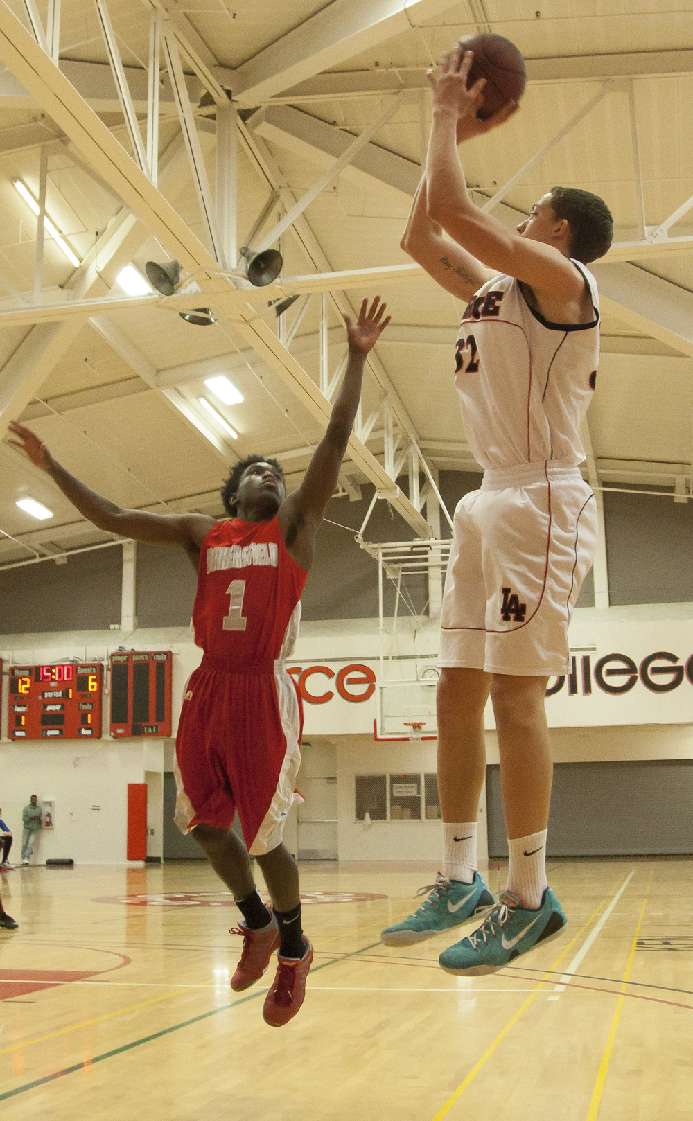 Pierce forward Trey Archambeau, shoots over Bakersfield College point guard Jameik Riviere in an important game that would decide which team advances to the playoffs. Pierce College would win the game in overtime, 95-92. Wednesday Feb. 25, 2015. Woodland Hills, Calif.  Full story  here