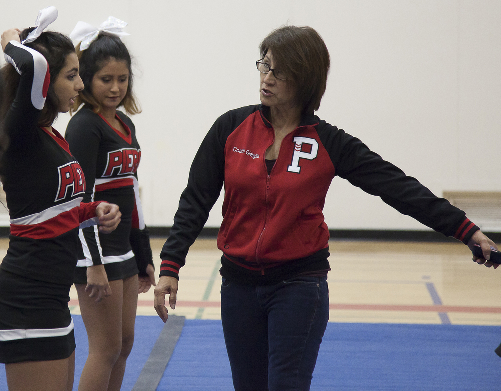 Cheer coach Jenny Ghiglia goes through the routine with Amanda Perez during practice in the North Gym on Sunday March 1, 2015. Woodland Hills, Calif.  Read the full story  here