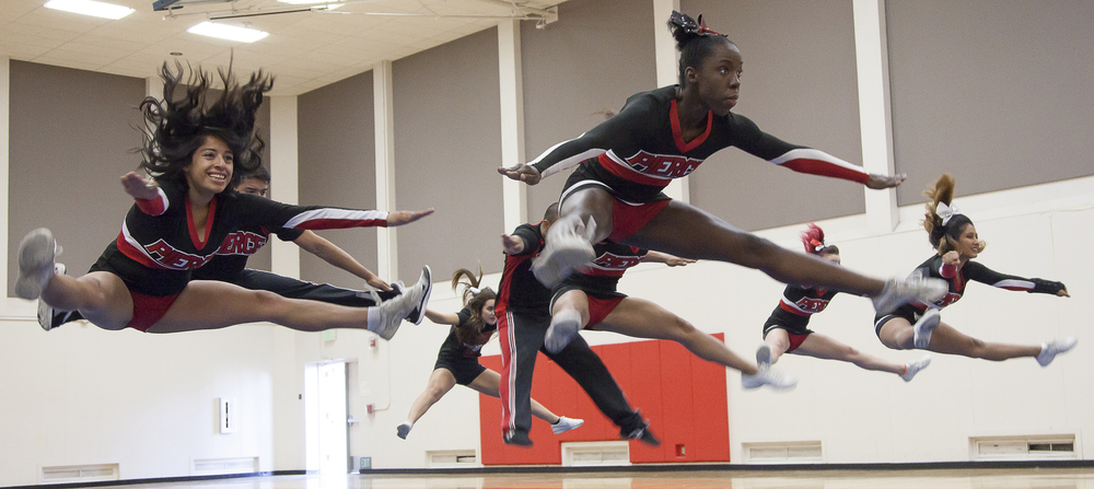 (From left-right) Dulce Rendon, Rushanda Duquesnay, Daisy Torres Barrera and other members of the Pierce Cheer Competition Team jump during a practice session in the North Gym on Sunday March 1, 2015. The jump is a part of the routine that will be used duing a competition at USC on March 14. Woodland Hills, Calif.  Read the full story here