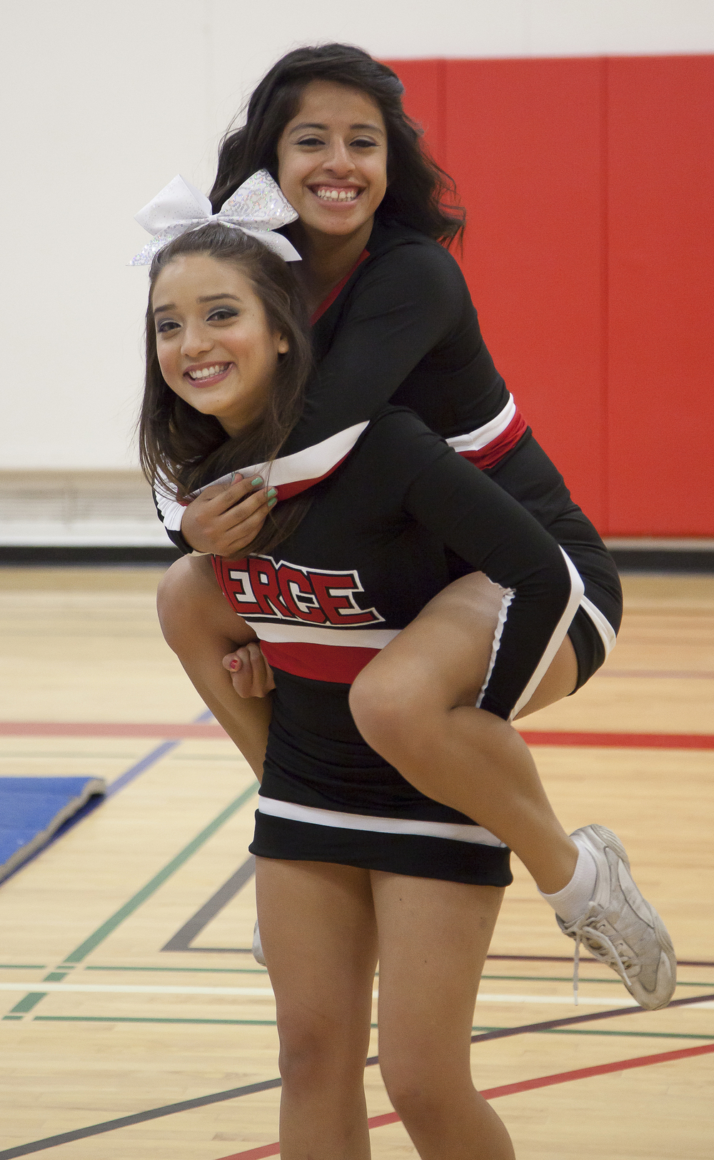 Vivian Herrera carries Dulce Rendon a break period inside the North Gym of Pierce College on Sunday March 1, 2015. Woodland Hills, Calif.  Read the full story here