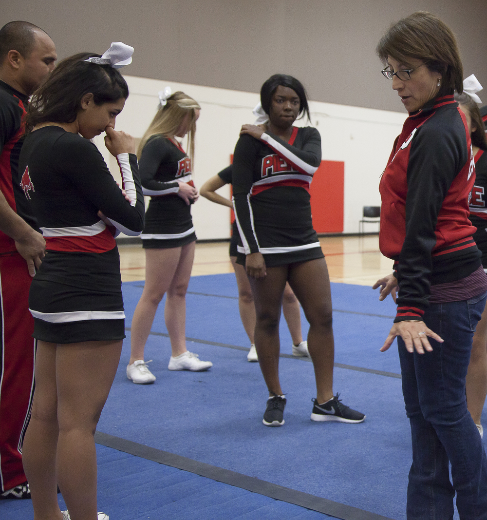 Coach Jenny Ghiglia goes over the routine while team members look on during a practice session in the North Gym on Sunday March 1, 2015. Woodland Hills, Calif.  Read the full story here