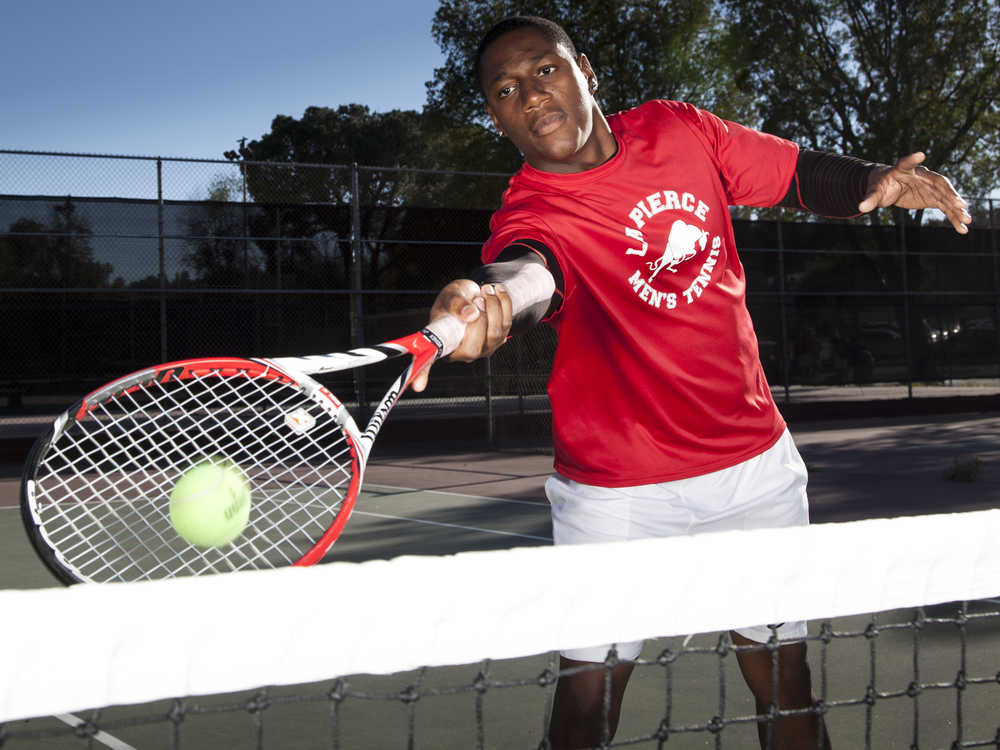 """""""Academics are important but I'm not working this hard to just be a buff dude with a B.A."""", said Jason Sturdivant, team captian of both the tennis and football teams. """"I'm trying to go the furthest."""" Thursday, March 12, 2015. Woodland Hills, Calif.  Read the full story  here"""