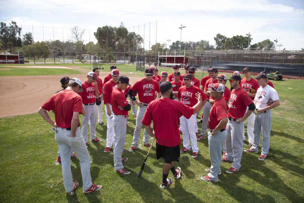 Assistant coach Willie Cabrera, center, meets with members of Pierce College's baseball team on Tuesday, March 10, 2015, to talk about the upcoming games the team will play for the semester. Woodland Hills, Calif.  Read the full story  here