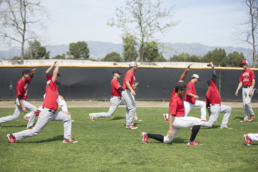Members of Pierce College's baseball team stretch at Joe Kelly Field before practice on Tuesday, March 10, 2015. Woodland Hills, Calif.  Read the full story here