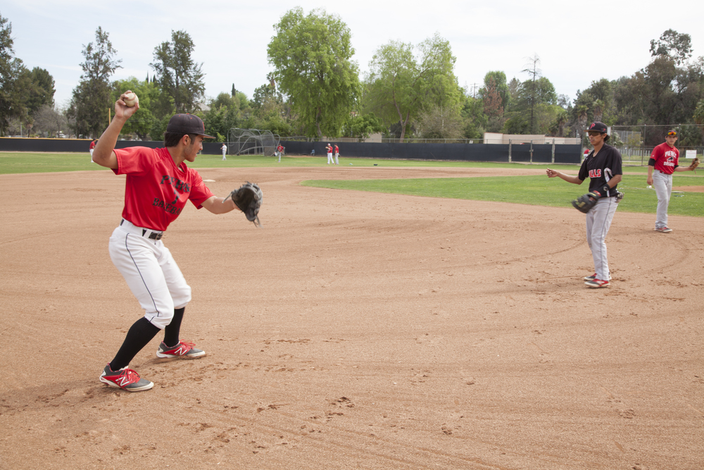 Jordan Abushala and Angel Cruz pair up to perform fielding plays at Joe Kelly Field on Tuesday, March 10, 2015. Woodland Hills, Calif.  Read the full story here