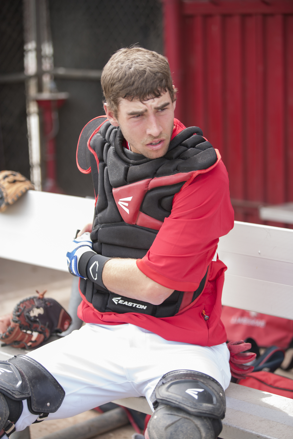 Evan Yeager suits up in a protective catcher's gear in the home team dugout at Joe Kelly Field on Tuesday, March 10, 2015. Woodland Hills, Calif.  Read the full story  here