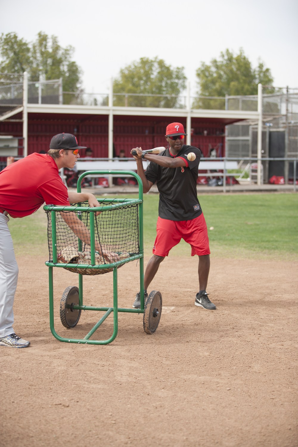 Devin Joblove and assistant coach Tyrus Powe hit balls for infielders to catch during a fielding drill on Tuesday, March 10, 2015. Woodland Hills, Calif.  Read the full story  here