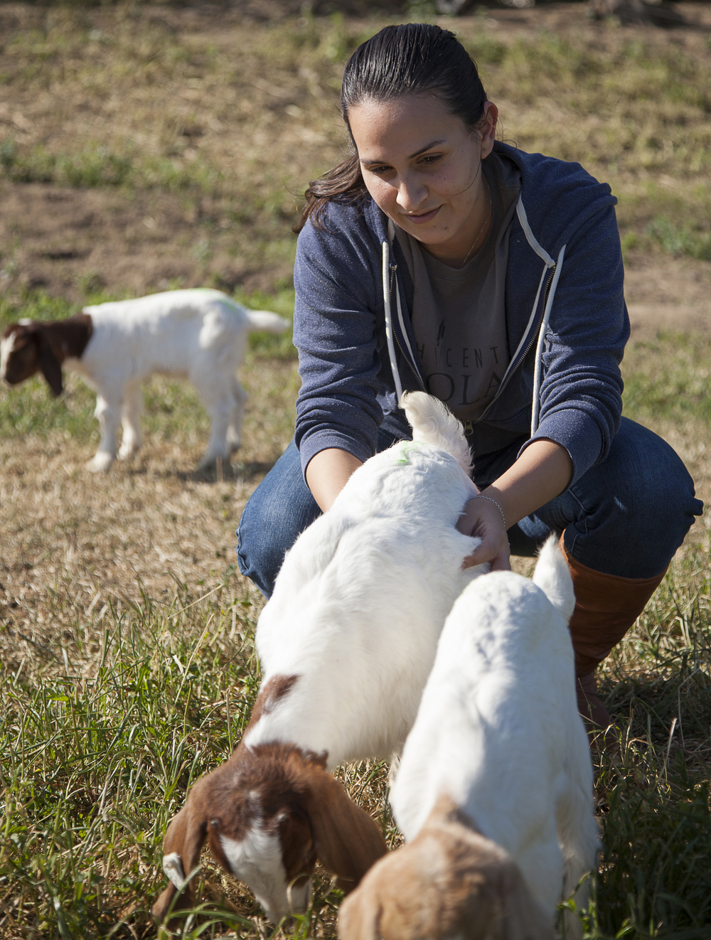 Georgina Martinez looks after two baby goats at the Pierce farm on Friday, March 20, 2015. Woodland Hills, Calif.  Read the full story  here