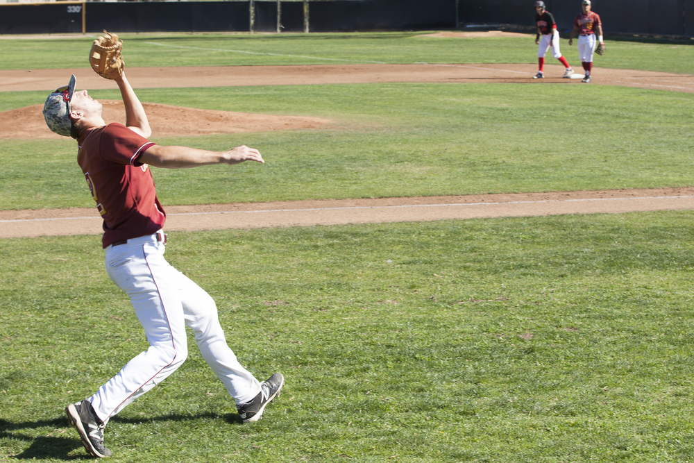 Glendale College 3rd baseman Frank Garriola catches a foul flyball in the second inning during a game against Pierce College in Woodland Hills, Calif. on Saturday, Feb. 13, 2016.
