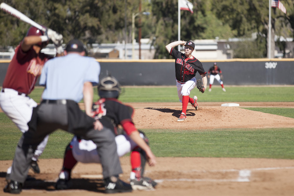 Brett Weisberg throws a pitch against a Glendale Vaquero during a home game in Woodland Hills, Calif. on Saturday, Feb. 13, 2016. Glendale would go on to win the game 15-6.