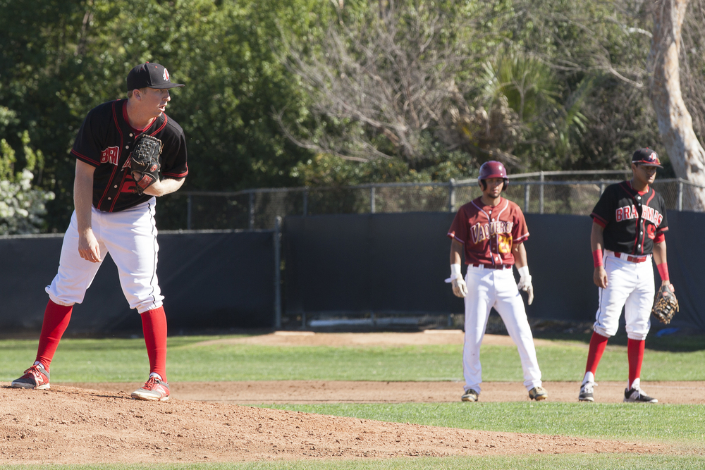 With a runner on 1st base, Brett Weisberg set his feet before throwing a pitch during a home game in Woodland Hills, Calif., against Glendale College on Saturday, Feb. 13, 2016. Glendale would win the game with a score of 15-6.
