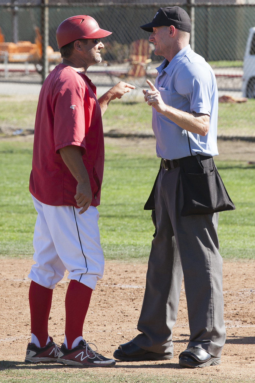 Coach Bill Picketts argues with the umpire over a non-hit batter call in the bottom of the second inning during a home game against Glendale College in Woodland Hills, Calif., on Saturday, Feb. 13, 2016.