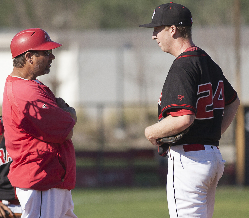 Bill Picketts has a meeting with Brett Weisberg on the mound in the top of the third inning before pulling Weisberg from the game. Weisberg had difficulty against the batters of Glendale College in a home game in Woodland Hills, Calif., on Saturday, Feb. 13, 2016. Glendale would win the game with a score of 15-6.