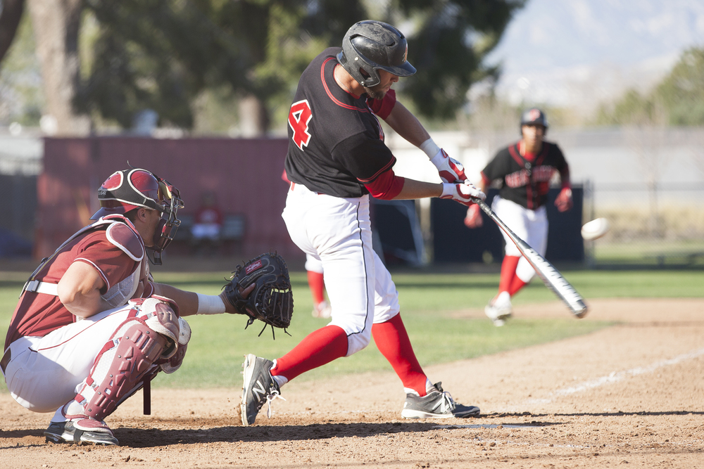 Evan Yeager of Pierce College hits a two-run RBI double to center field with runners in scoring position during a home game in Woodland Hills, Calif. against Glendale College on Saturday, Feb. 13, 2016.