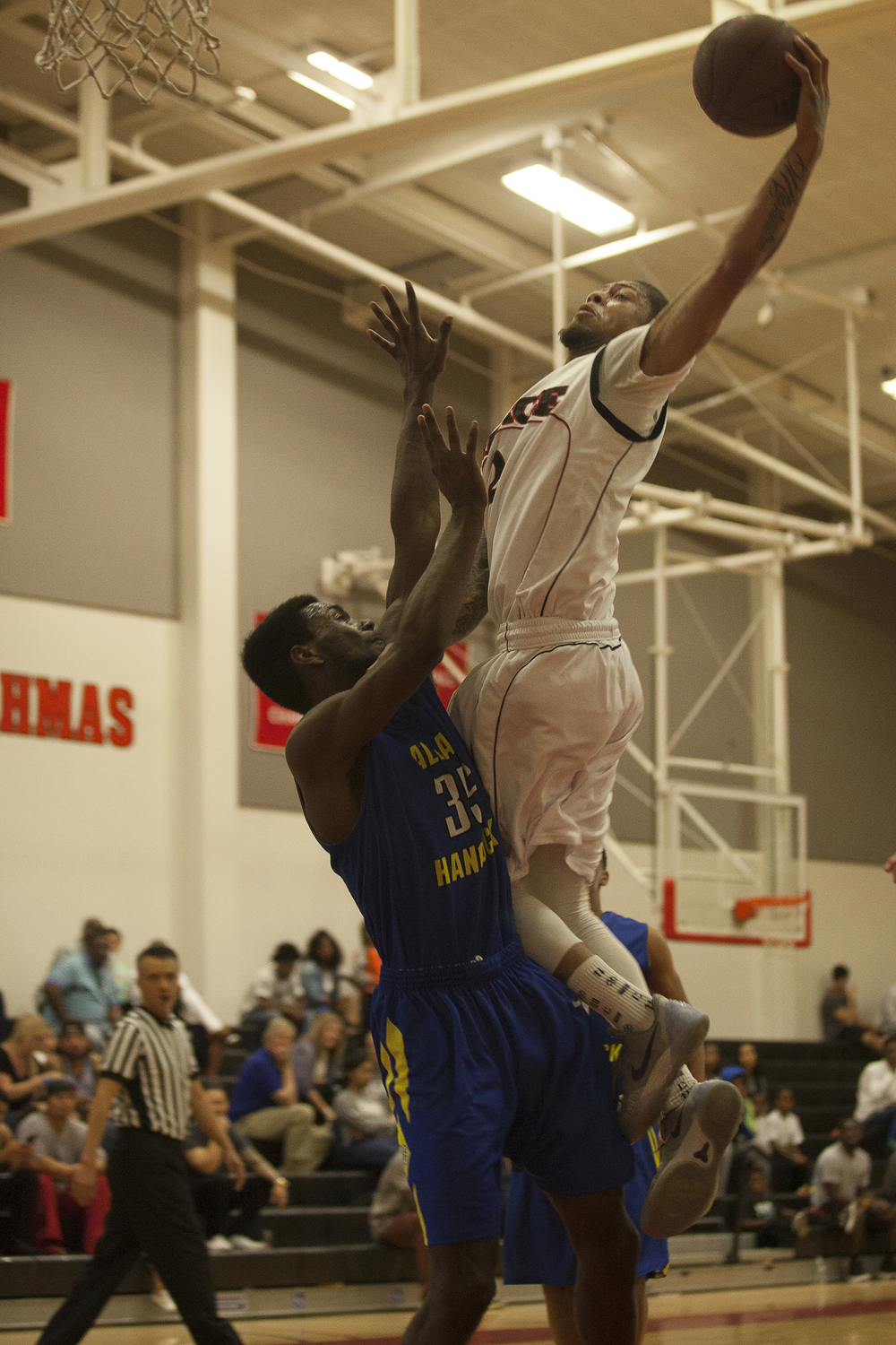 Hancock center Tim Ford guards Kenny Stenhouse as he attempts a dunk during a Pierce home game on Saturday, Feb. 13, 2016 in Woodland Hills, Calif.