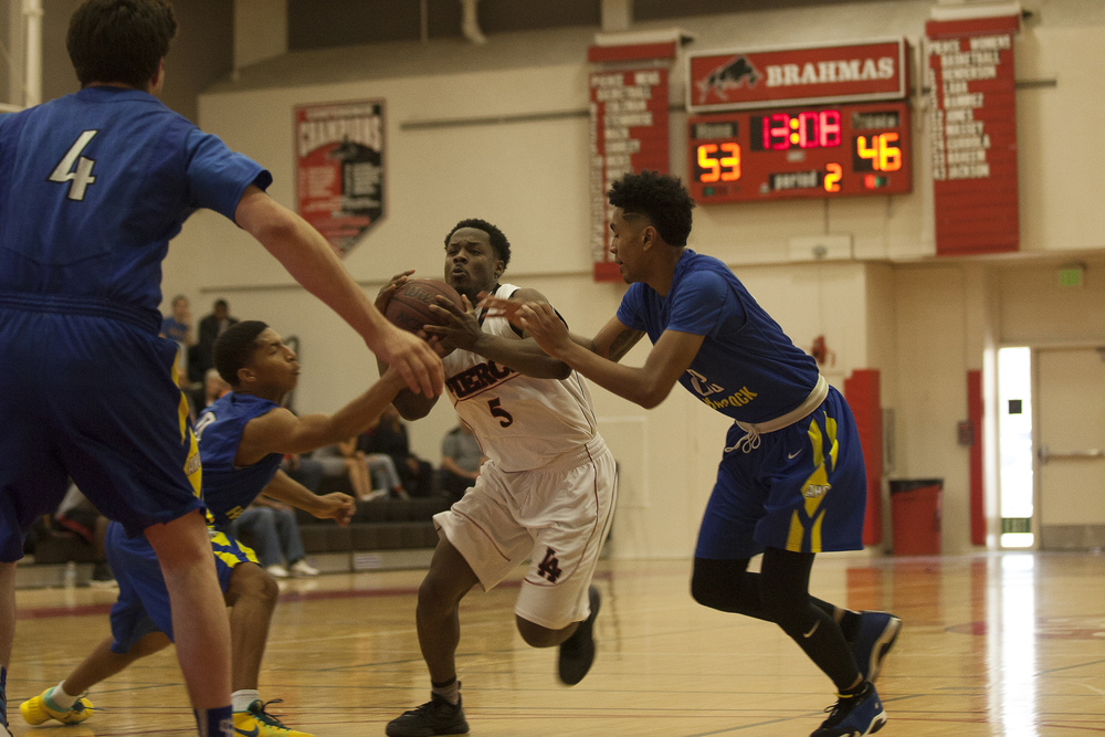 Montel Shirley drives between Allan Hancock defenders in the second half during a home game on Saturday, Feb. 13, 2016 in Woodland Hills, Calif. Pierce would go on to win the game in overtime with a score of 95-91.