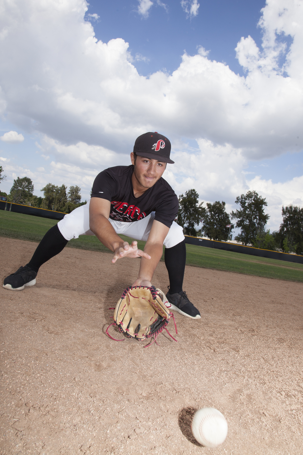 """""""It's so much more than just physical abilities. It's a lot of mental stuff and you have to be thinking after every pitch and action the whole game,"""" said Jordan Abushala about playing the game of baseball. Abushala fields a ground ball at Joe Kelly Field in Woodland Hills, Calif. on Monday, April 11, 2016."""
