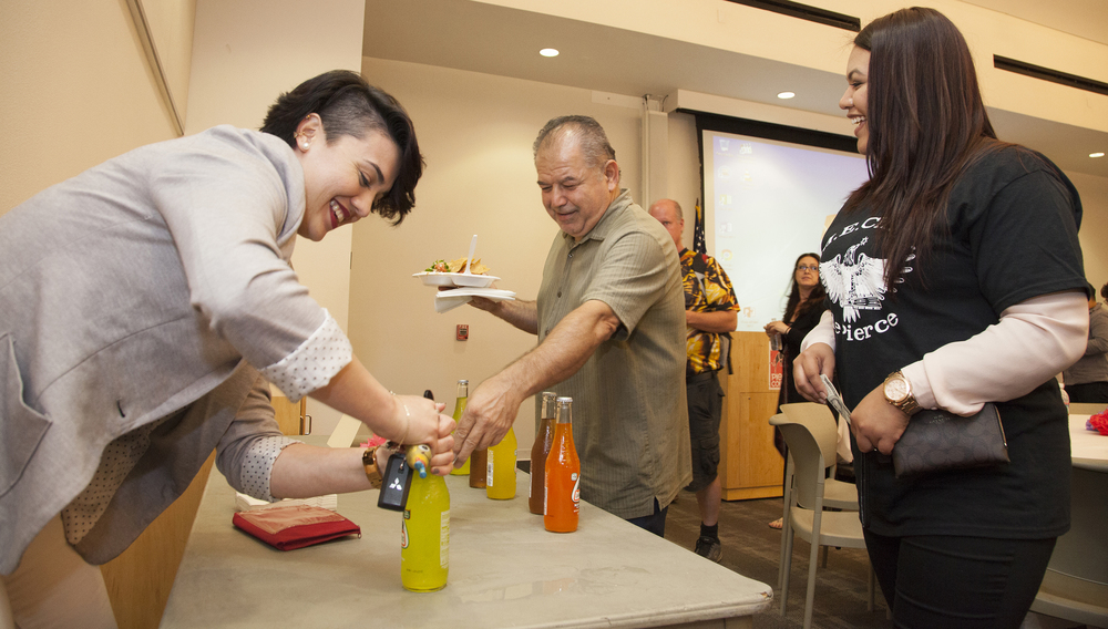 Melissa Robles, a member of M.E.C.H.A. de Pierce, opens up bottles of Jarritos during the 1st Annual Cinco de Mayo Celebration inside The Great Hall in Woodland Hills, Calif. on Thursday, May 5, 2016. Grupo Ajolote begin an Aztec ritual inside The Great Hall in Woodland Hills, Calif. on Thursday, May 5, 2016, for the 1st Annual Cinco de Mayo Celebration. Cinco de Mayo marks the event when the Mexican army defeated the French forces at the Battle of Puebla.