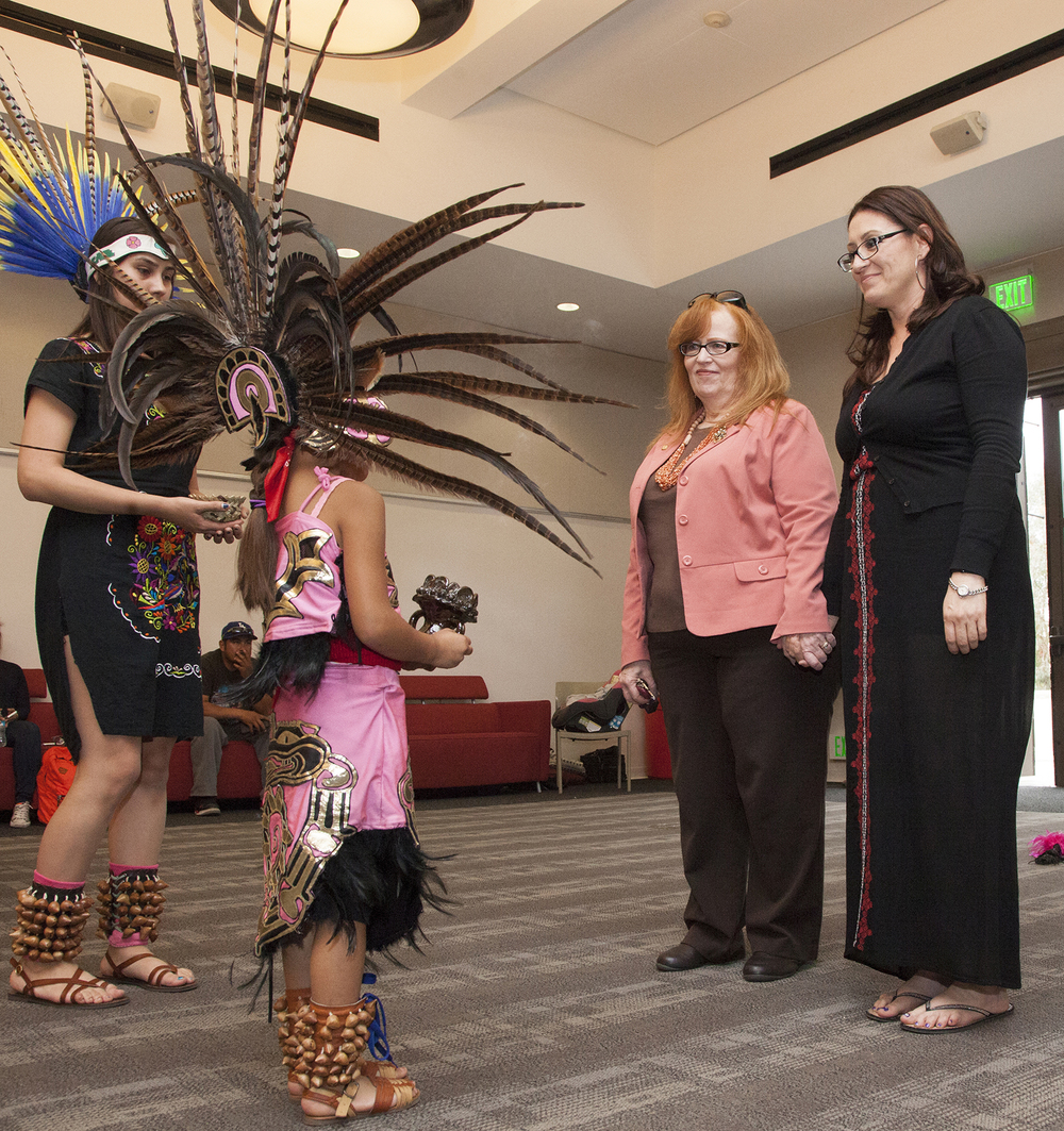 Vallerie Flores prepares to bless Pierce College President Kathleen Burke, center left, and Angelita Rovero, professor of Chicano Studies, center right, in an Aztec ritual during the 1st Annual Cinco de Mayo Celebration inside The Great Hall in Woodland Hills, Calif. on Thursday, May 5, 2016. Cinco de Mayo marks the event when the Mexican army defeated the French forces at the Battle of Puebla.