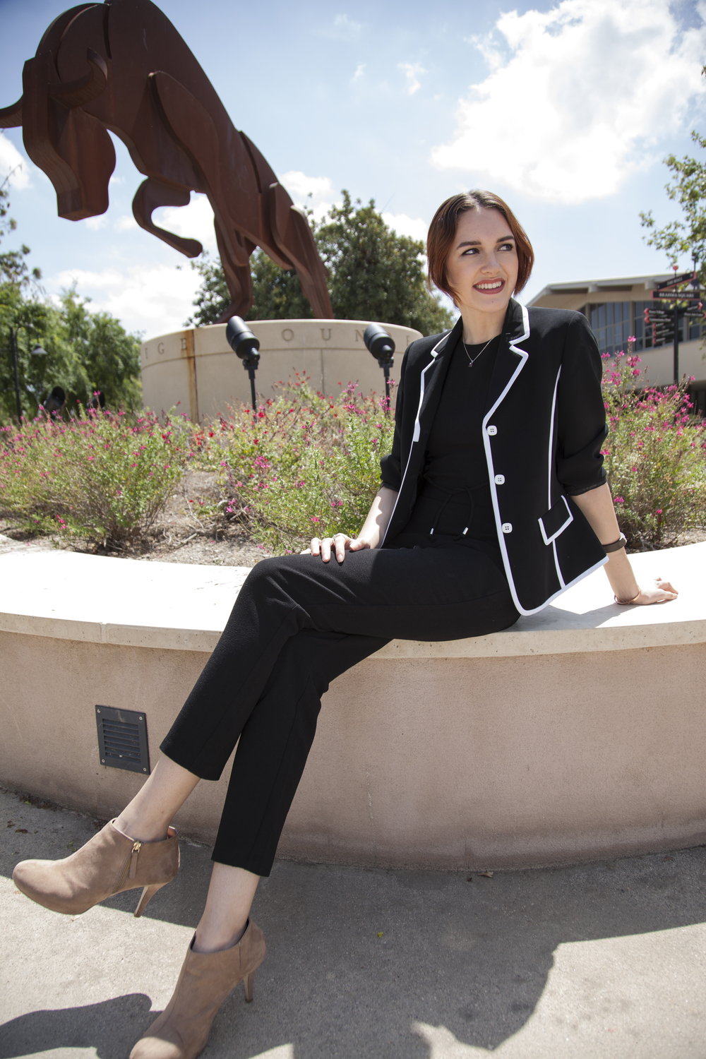 Jamie Daugherty, a 21-year-old communications major, has appeared on shows such as Girls Rock, Luscious Waves, Coco Rocha, and FAB Life. Daugherty sits in front of the Bull sculpture on The Mall of Pierce College on Wednesday, April 20, 2016 in Woodland Hills, Calif.