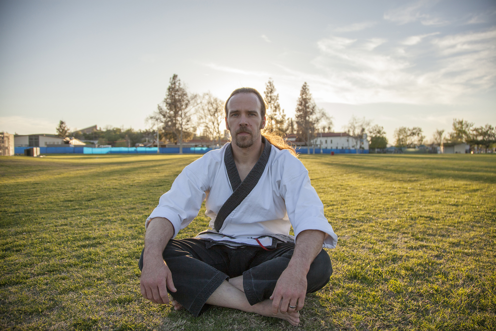 Nathan Carlen, an instructor of martial arts and a professor of kinesiology, sits in a lotus position on the campus of Pierce College in Woodland Hills, Calif. on Thursday, Feb. 25, 2016.  Read more of Carlen's story   here  .