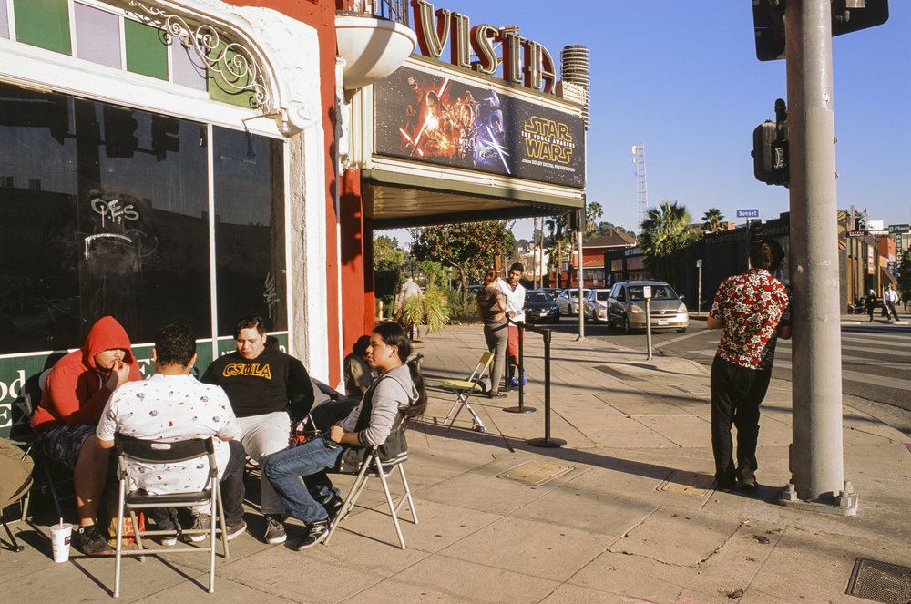 Fans of Star Wars wait in line for the premier of Star Wars: The Force Awakens at the Vista theater in the Los Angeles community of Silverlake. Dec, 2015