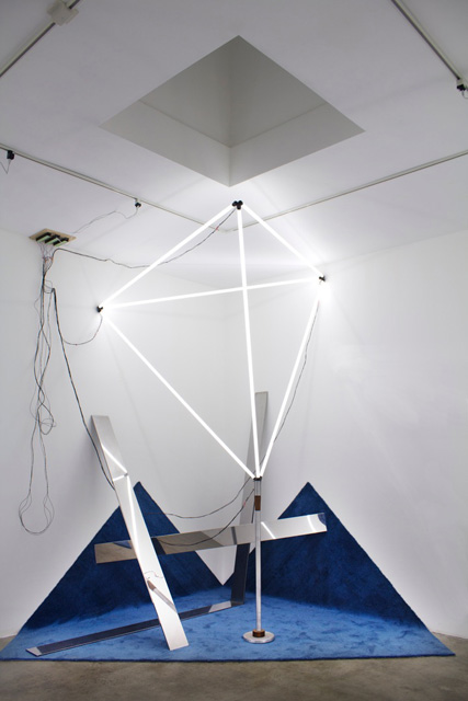 Jason Peters Site-specific installation, 2012 Fluorescent tubes, carpet & found objects Approx. 20 x 20 x 12 feet