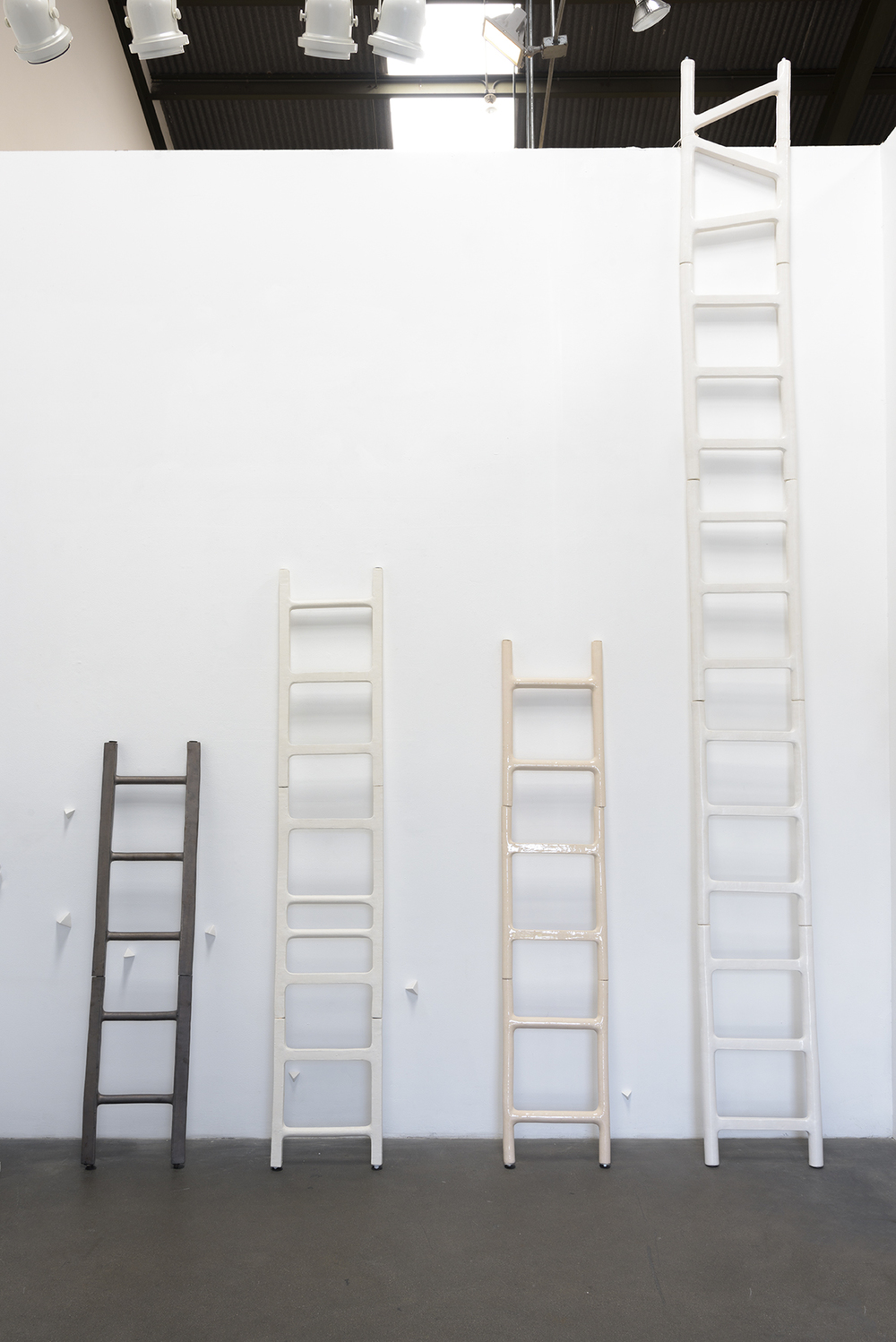 Elizabeth Orleans (Glazed ceramic ladders: Left to Right)  Proceed , 2016: 58 x14 x2 inches  Elevate , 2016: 82.5 x 15 x 1.5 inches  Peach Progression , 2016: 72 x 14.5 x 1.5 inches  Escape , 2016: 158 x 15.75 x 1.75 inches