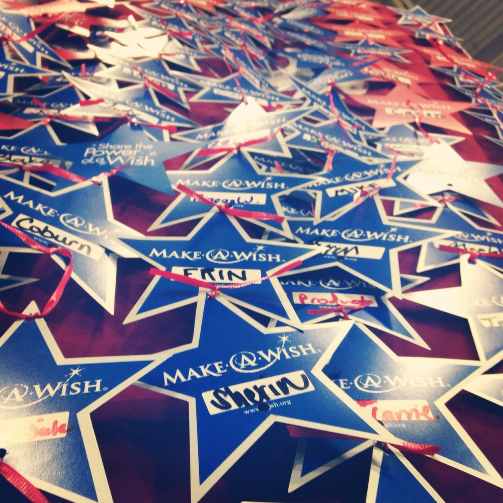 Donation stars representing contributions to Make-A-Wish Utah from convention attendees.
