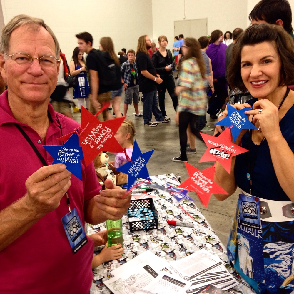 Liz and her dad, Bruce Boggess tying stars together at the Rebel Legion booth.
