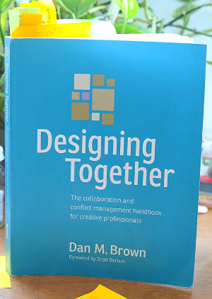 My heavily bookmarked copy of Designing Together by Dan M Brown