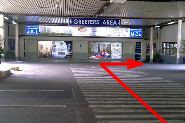 Pic 1. Upon exiting Terminal 1 Arrivals, cross to the Greeter's Area and take the RIGHT ramp
