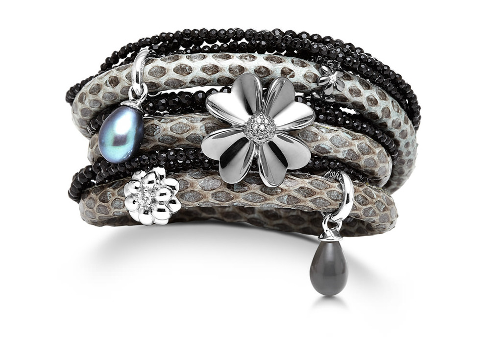 Gray snake skin leather wrap bracelet with silver charms and an onyx wrap bracelet