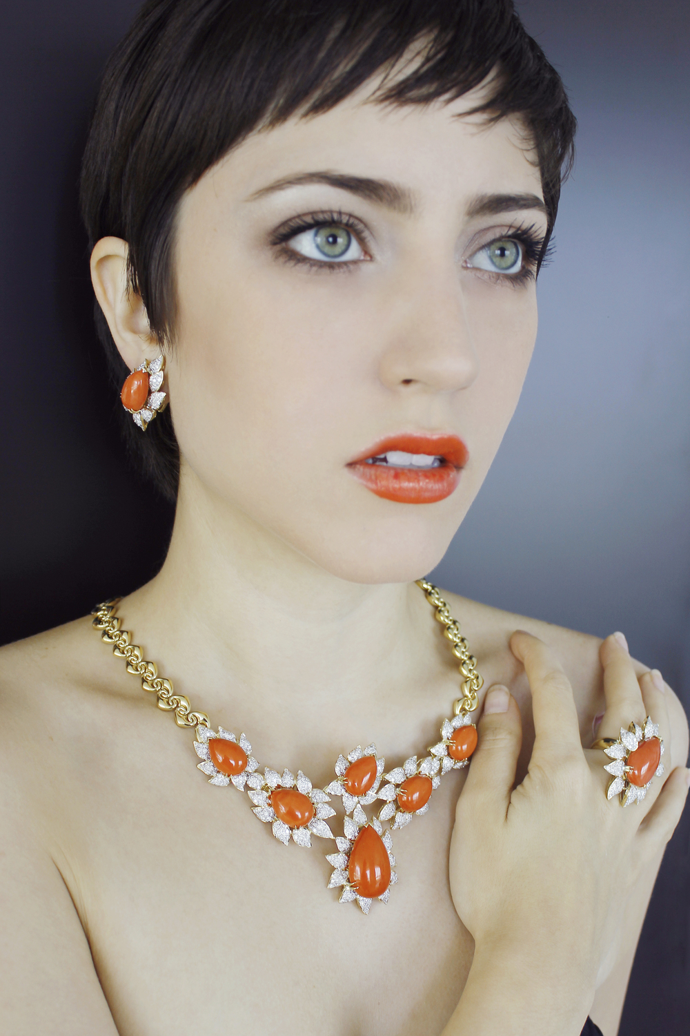 18 karat gold earring, ring, and necklace set with high quality coral