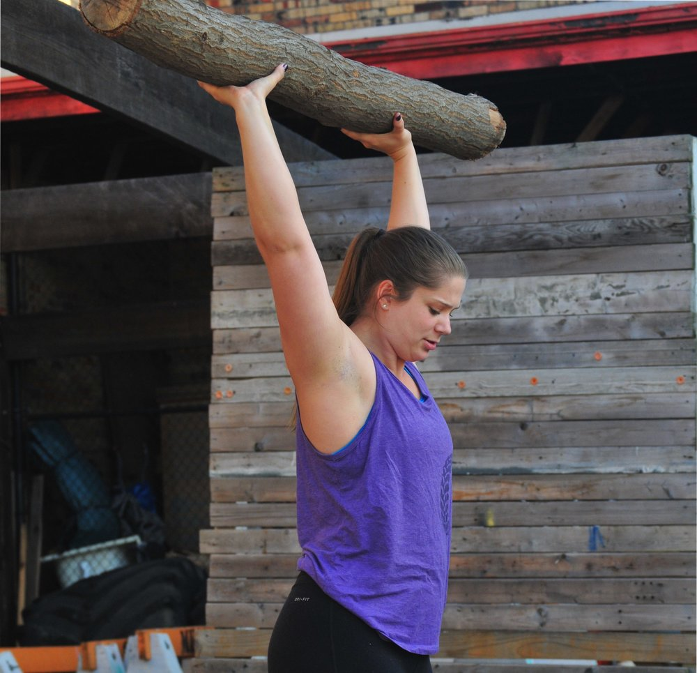 Anna holding up log.jpg