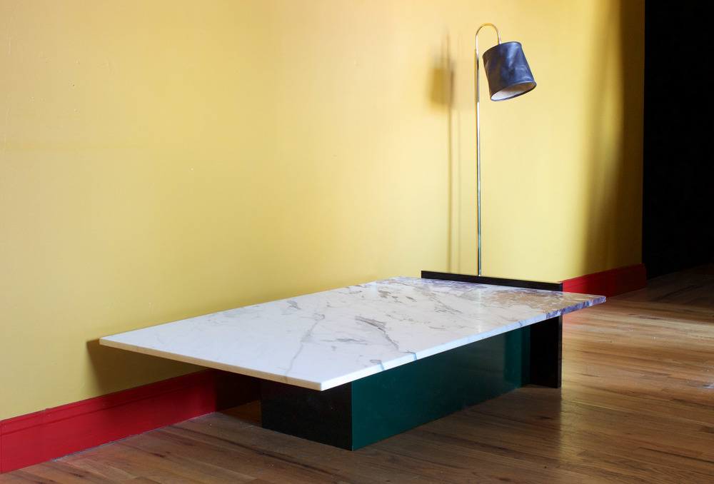 Coffee table in Paonazzo marble, black polished acrylic and high gloss oil on wood; Series 01 floor lamp in charcoal leather,2015.