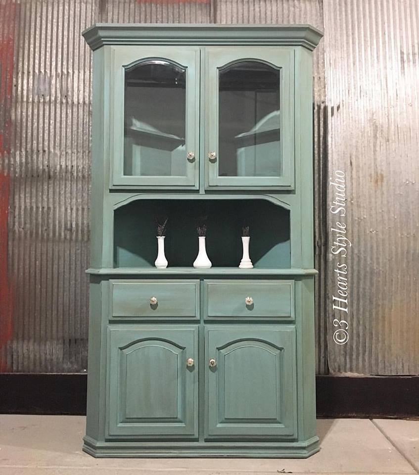Teal hutch with mercury glass hardware