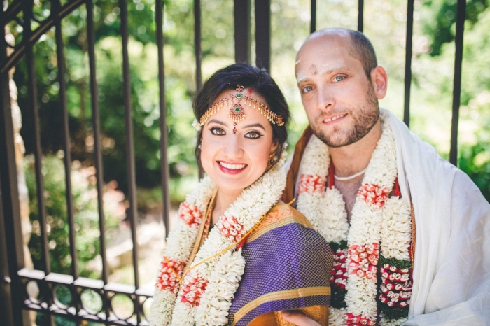 featured weddingAnusha & Andrew - Click to see more about this vibrant, colorful, backyard wedding complete with a sail cloth tent, café lighting, Indian inspired hors d'oeuvres, bright colorful florals, wood top tables and more.