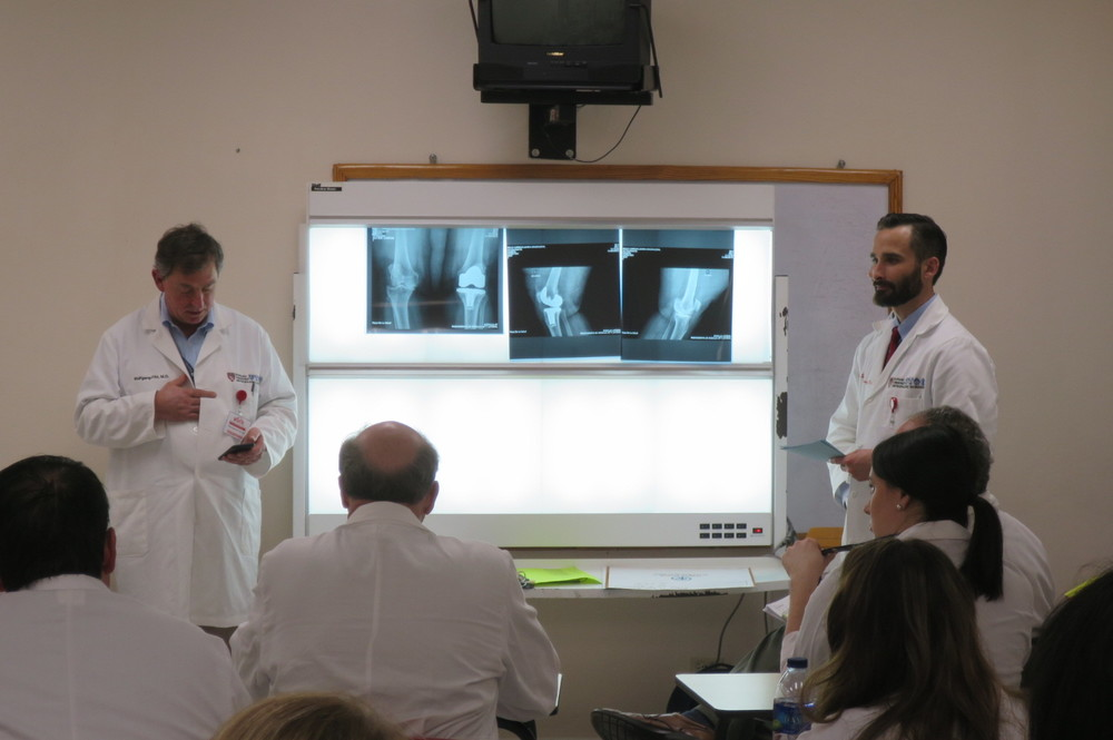 Dr. Wolfgang Fitz (left) and Dr. Dustin Hambright (right, PGY-5) discuss a patient with the Op Walk group