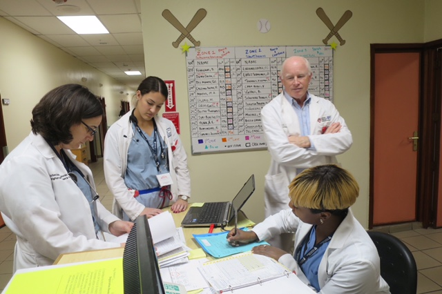 Barbara Aggouras NP (left), Courtney Gouthro RN (middle) and Aliesha Wisdom RN (right) discussing patient care with Dr. John Ready.