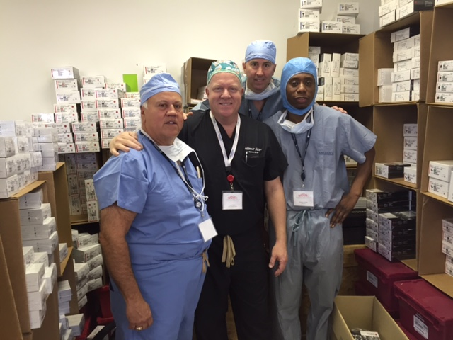 Representatives from Depuy Synthes with the donated implants. From left to right--Dom Dinardo, Josh Eaton, Jim Curran and Kesner Conille.