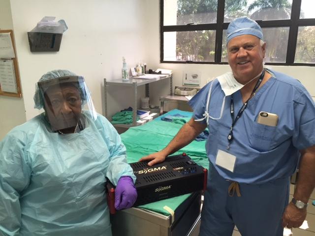 Nicky Champagne and Dom Dinardo working to prepare implant kits