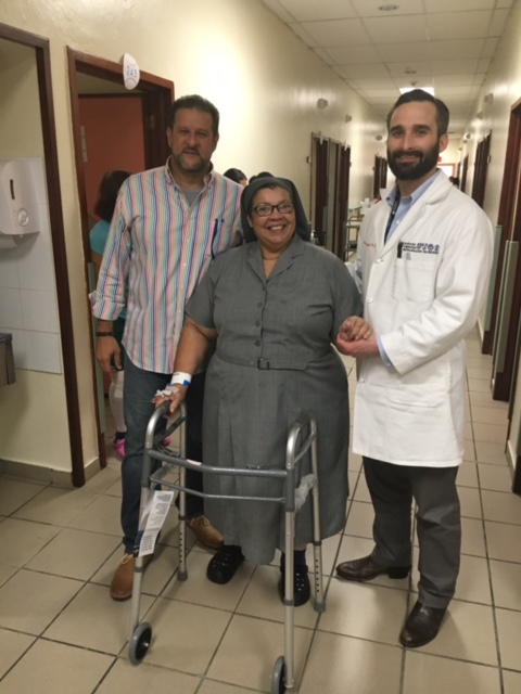 Dr. Luis Alcantara and Dusty Hambright (PGY-5) with one of the patients on the day of discharge.