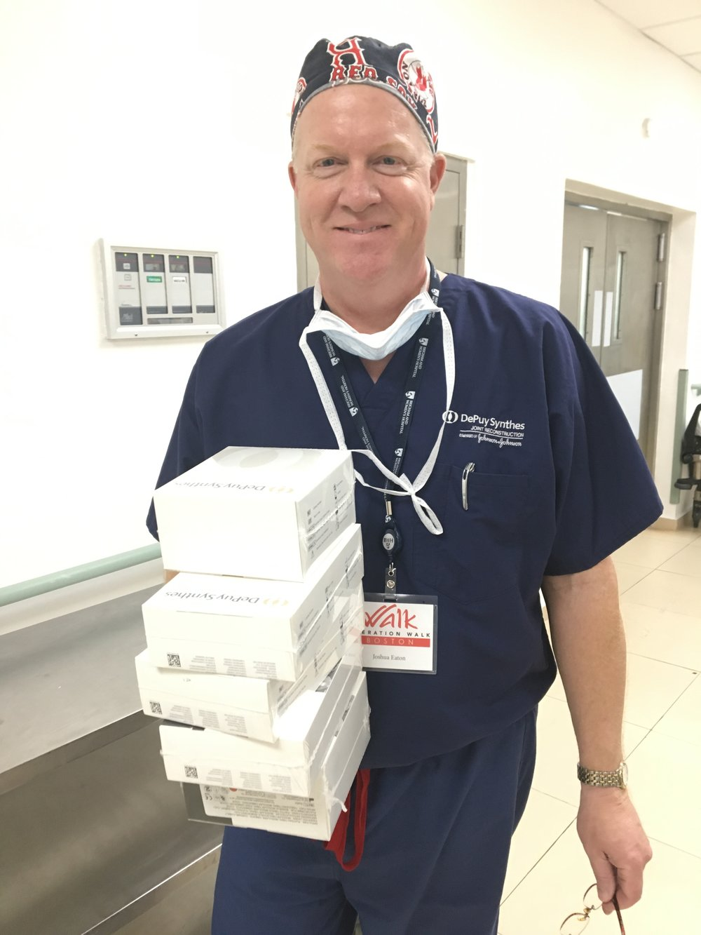 Josh with Johnson & Johnson (DePuy Synthes)helping to deliver the implants to operating room.