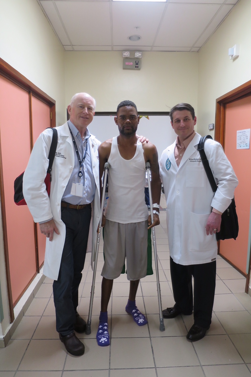 Dr. Ready and Dr. Sherman visiting with one of the team's post-operative patients.