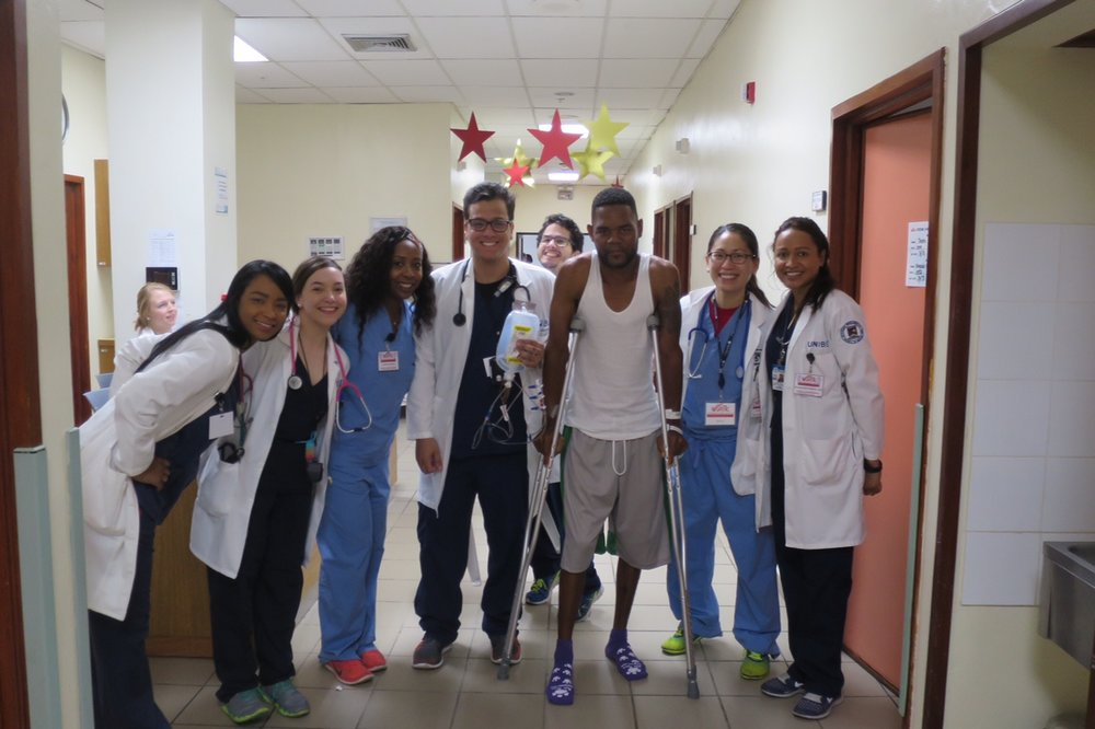 The team of nurses, physical therapy, and UNIBE medical students helping with patient rehabilitation after surgery.